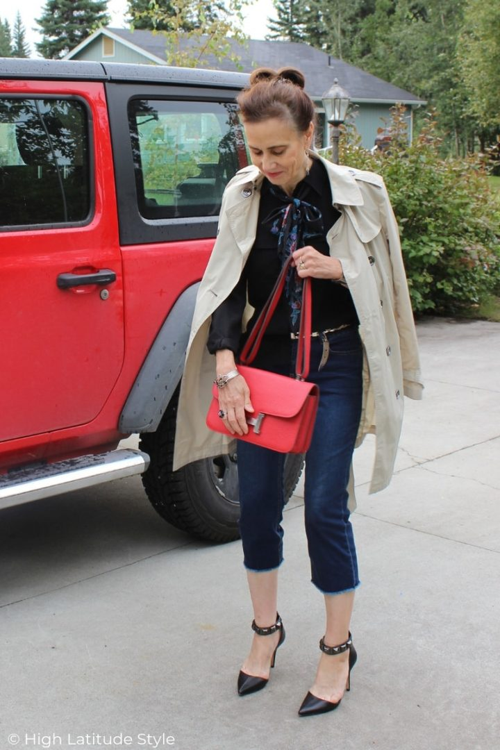 style blogger in all neutral color cropped pants, blouse, scarf, trench, pumps outfit with pop of red